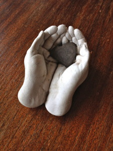 These small clay hands & found stone 'heart' sit on my desk.  For we all simply to hold & be held with love.